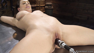 Busty Milf gets machine in shaved cunt