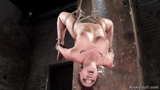 Busty slave in back arch suspension whip