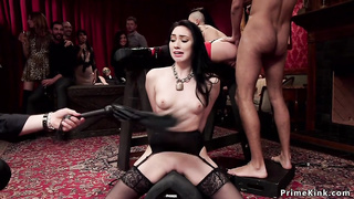 Brunette gets paddle in bdsm orgy party