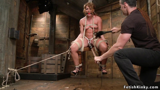Sub torment in chair suspension bondage