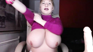 MOnster tits blonde plays with dildo