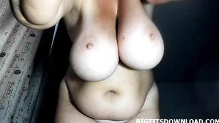 Fat busty woman standing up