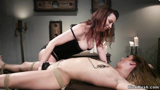 Gagged tied brunette lesbian anal banged