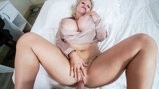 Busty MILF rides dick while bouncing her huge tits