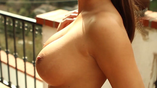 Enlarged boobs look great on this MILF