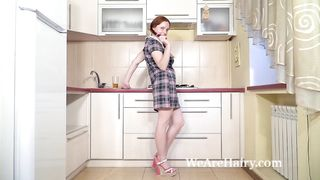 Elouisa strips naked in her kitchen to play naked